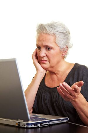 computer problems: A senior woman working on a laptop