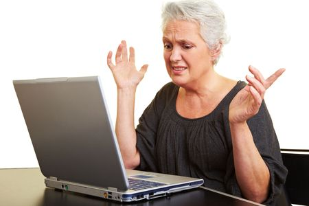 cutout old people: A senior woman working on a laptop