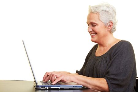 A senior woman working on a laptop photo
