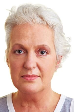 frontal portrait: Indifferent senior woman looking into the camera