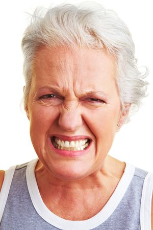 insult: Angry senior woman looking into the camera Stock Photo