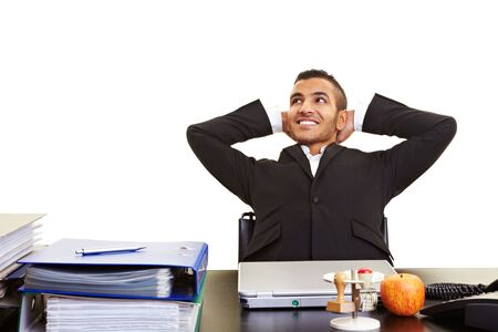 Young moroccan manager leaning back at his desk photo