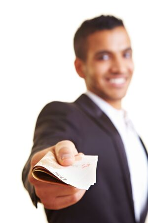 Young business man offering a stack of money photo