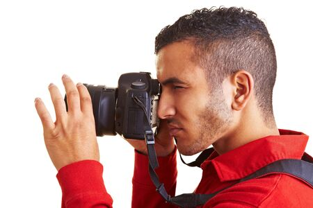 profile picture: Young man looking through viewfinder of digital camera Stock Photo