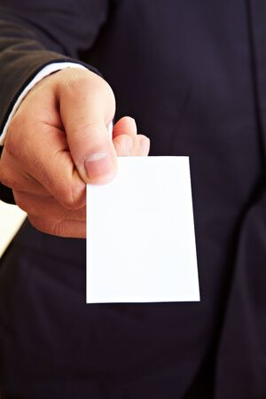 business card hand: Manager holding an empty white business card