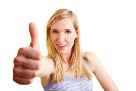 Young blonde woman holding her thumb up Stock Photo - 6735744