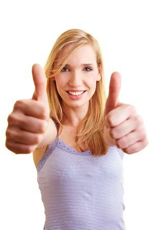 Young blonde woman holding two thumbs up Stock Photo - 6735727