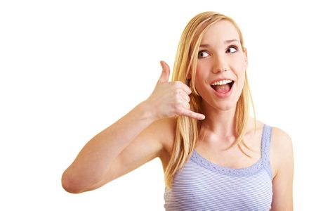 Young blonde woman showing a call gesture with her fingers Stock Photo - 6735732