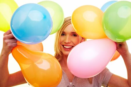 Young happy woman holding many colorful balloons Stock Photo - 6735726