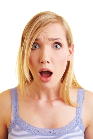 Young blonde woman looking surprised into the camera photo