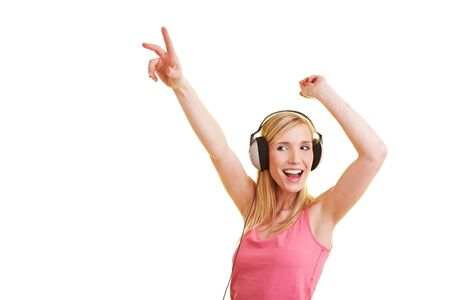 Young blonde woman listening to music with headphones photo