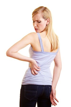 dorsalgia: Young blonde woman touching her aching back