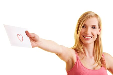 Young blonde woman with a love letter in her hand photo