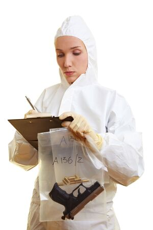 Female forensic scientist holding weapon and ammunition Stock Photo - 6857929