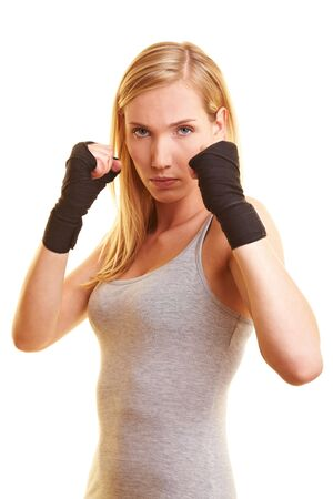boxing training: Young boxing woman with black hand bandage
