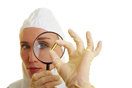 Female forensic scientist holding ammunition as evidence Stock Photo - 6858504
