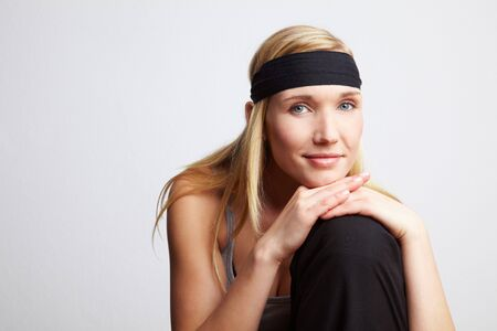 releaxed: Young releaxed woman with black headband smiling