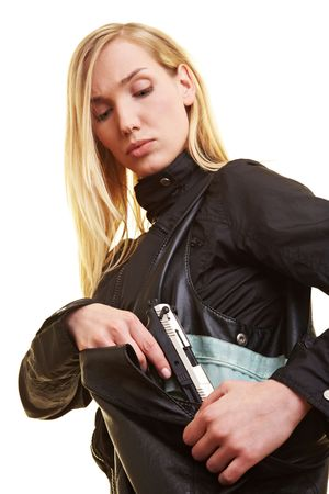 handbags: Young blonde woman pulling a pistol out of her handbag