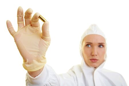 Female forensic scientist holding ammunition as evidence Stock Photo - 6858058