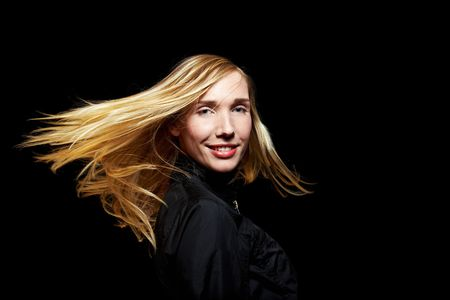 Young blonde woman with waving hair in the dark Stock Photo - 6858064