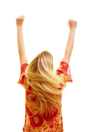 young cheering: Cheering woman from behind with flying hair and clenched fists Stock Photo