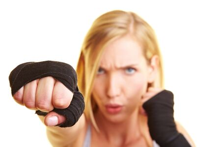 Young boxing woman with black hand bandage photo
