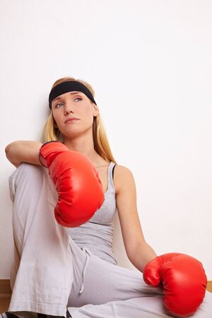 Young female boxer sitting on the floor Stock Photo - 6860500