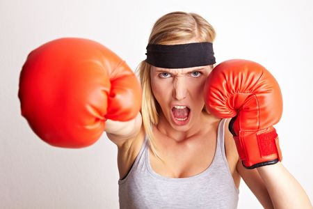 Young female boxer with red boxing gloves and headband Stock Photo - 6860531