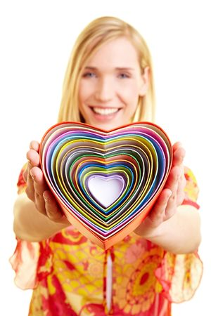 Smiling young woman holding many colorful hearts photo