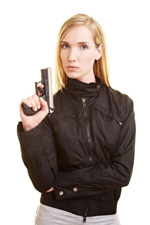 Young blonde woman holding a pistol in her hand photo