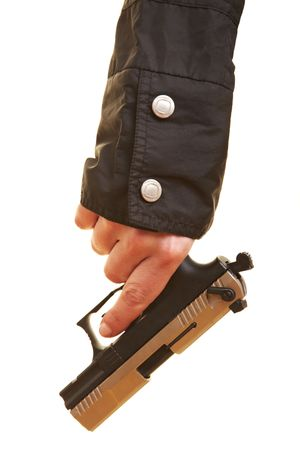 Female hand holding a pistol pointing down photo