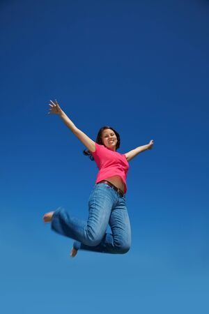 young happy asian woman jumps into the air Stock Photo - 7222618