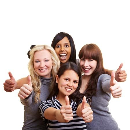 alabanza: Cuatro mujeres j�venes felices celebrando sus pulgares