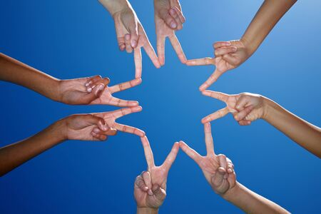 four hands: Eight hands form a star with their fingers