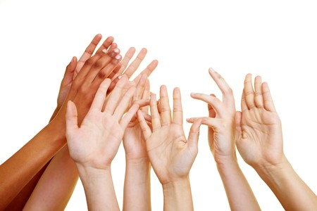 request: Many desperate hands reaching into the air Stock Photo
