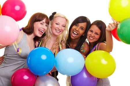 suspens: Quatre jeunes femmes heureuse avec nombreux ballons color�s