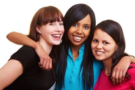 European, African and Asian women smiling together photo