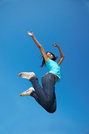 Young african woman jumping into the air Stock Photo - 7222700