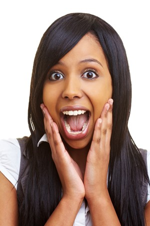 amazed face: Young african woman looking surprised into the camera