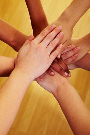Many hands lying on top of each other Stock Photo - 7230700