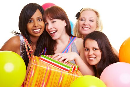 Four happy young women with gifts and balloons Stock Photo - 7230615