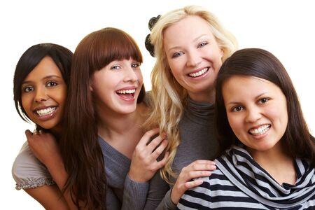 persona feliz: Cuatro j�venes mujeres sonrientes felices agrupados  Foto de archivo