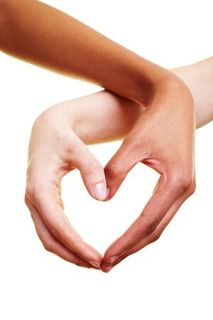 hearts and hands: Two hands form a heart shape with their fingers