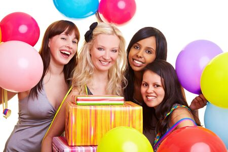 Four happy young women with many colorful balloons photo
