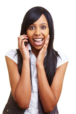 amazement: Young happy african woman talking into her cell phone