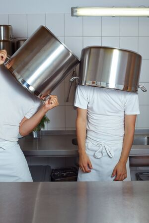 hideout: Two cooks having fun with big pots