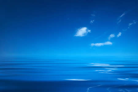 location shot: Blue ocean with a sky and a few clouds