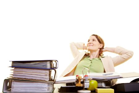 lean back: Satisfied businesswoman at her desk leaning back Stock Photo
