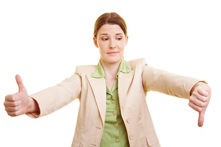 Young businesswoman holding her thumb up and down Stock Photo - 7359860