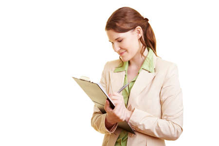 Happy female coach holding clipboard and pen Stock Photo - 7359504